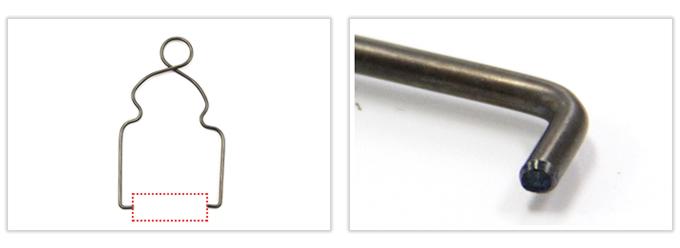 トーション部分をもつハンガー形状線材加工品