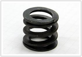 狭いスペースで、たわみ量が多い、且つ重荷重に耐え得る圧縮バネ